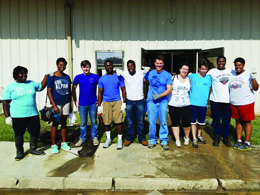 Chi+Alpha+students+take+a+break+from+cleaning+Faith+Worship+Center.+The+student+group+went+to+Baton+Rouge+to+help+clean+up+after+the+flooding.+Photo+credit%3A+Alliciyia+George