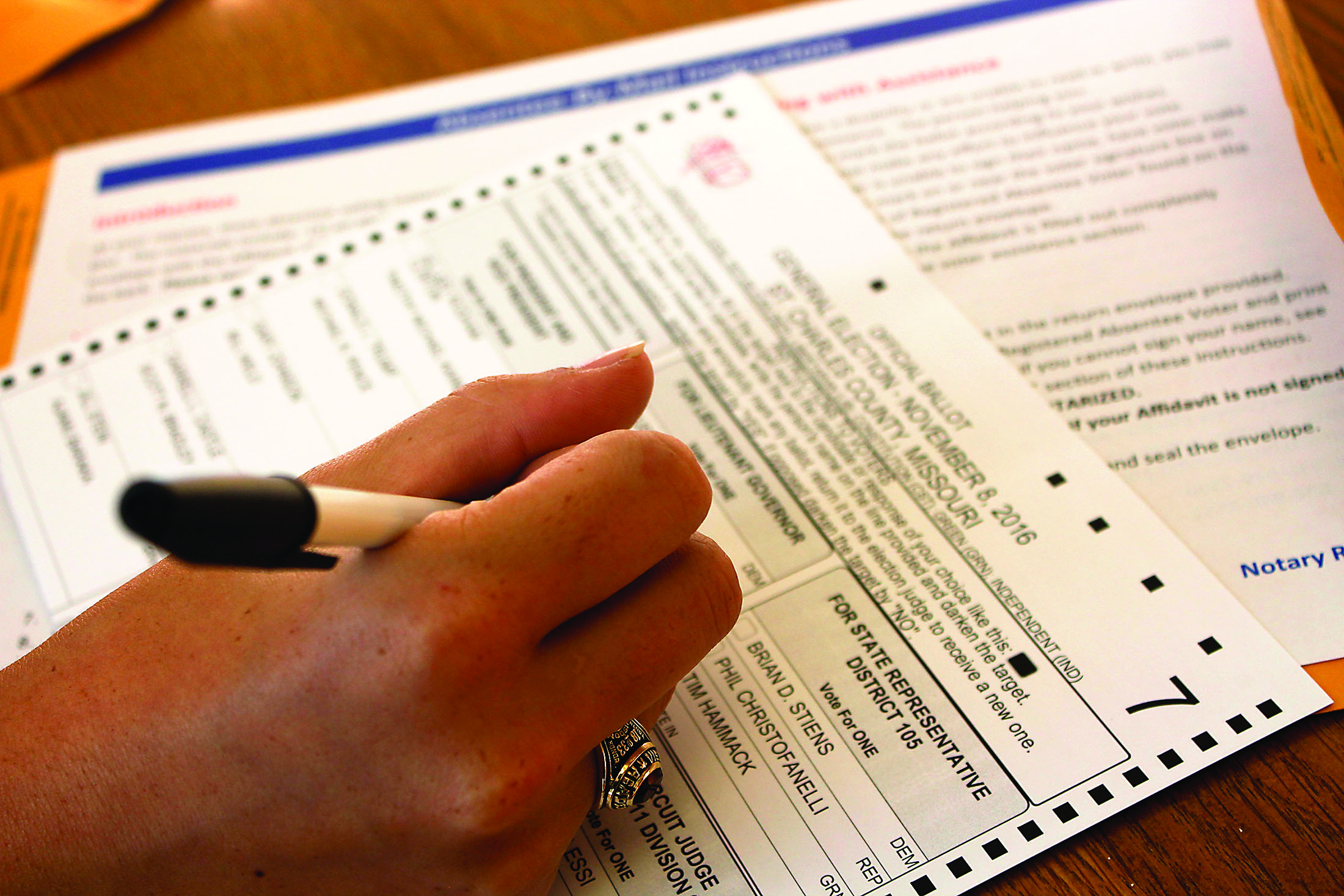A student fills out an absentee ballot. Photo credit: Alliciyia George