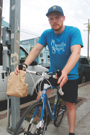 Brendan Dodd, also known as Bagel Boy,  is seen here performing his usual bagel deliveries across Uptown New Orleans.  Dodd delivers leftover bagels from Humble Bagel to people who request them on Tulane Classifieds.