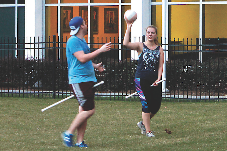 A'16  Tyler Steele, exhange student Carolin Tigges and music industry junior Peter De Armas toss a ball during quidditch practice. The Quidditch team hosted a tournament on Oct. 1 and beat the University of Southern Mississippi and Tulane.
