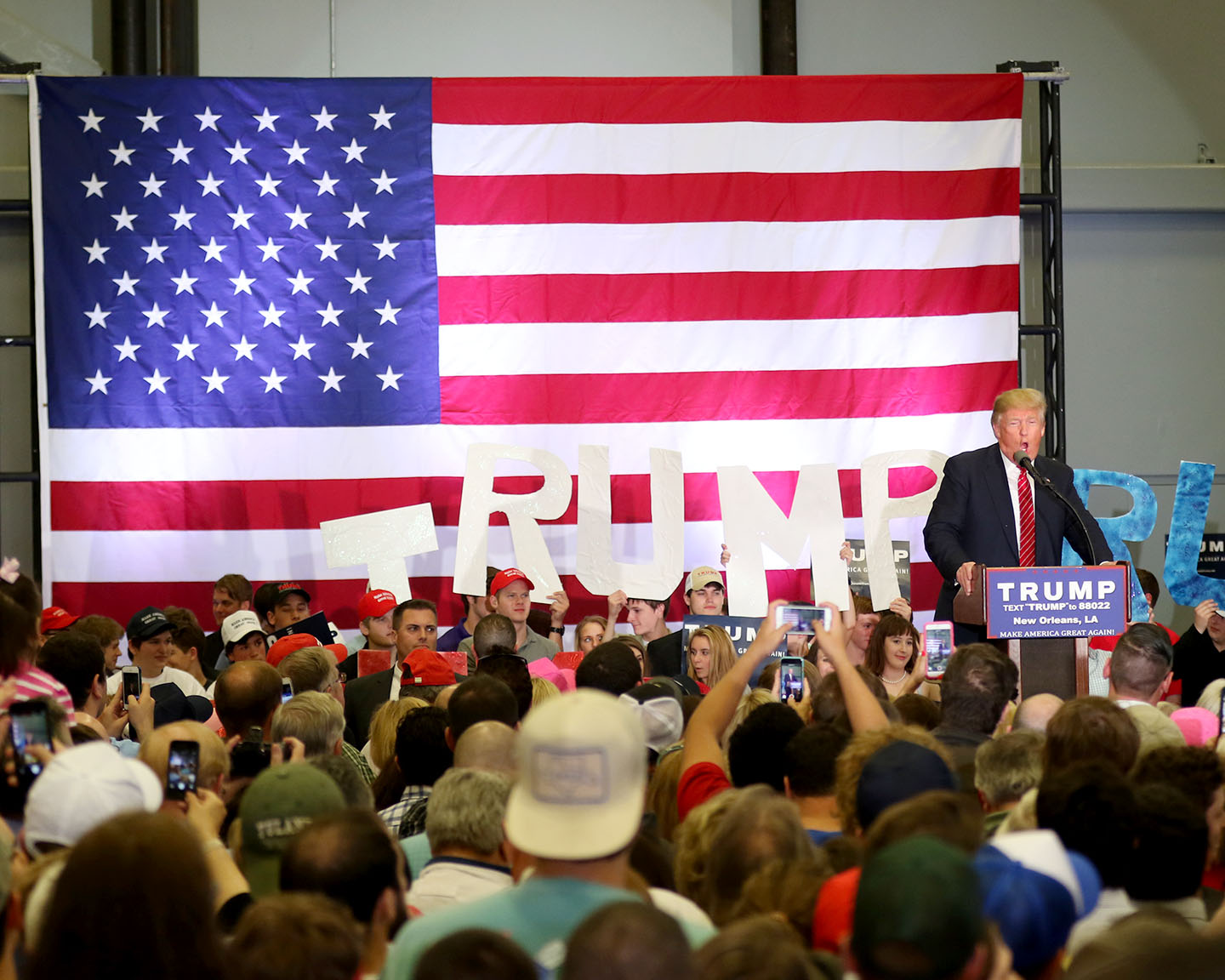 Donald Trump delivers his speech. Trump, the leader in the 2106 Republican presidential race, held a rally at the Lakefront Airport on Friday, March 4, 2016.