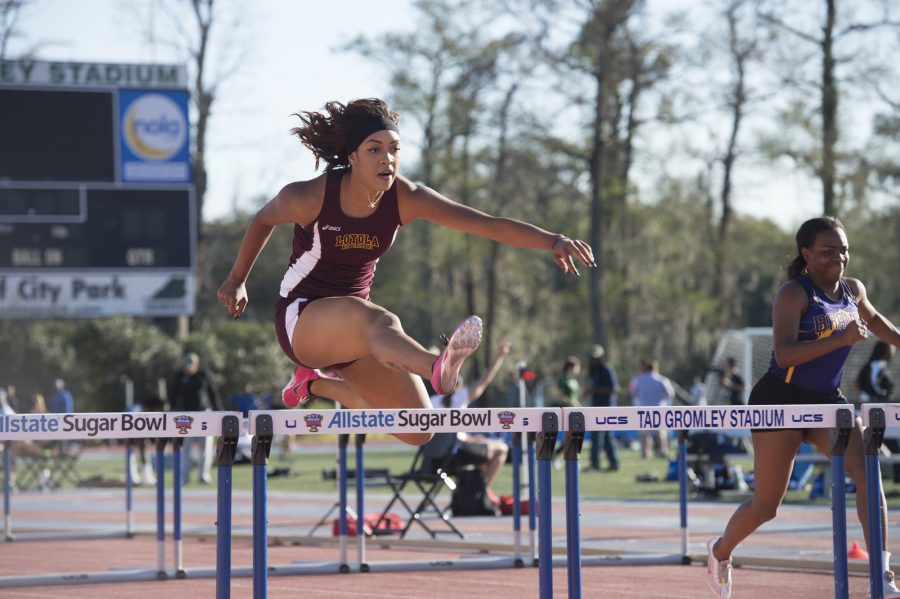 Sophomore+Asia+Marie+Kelly+jumps+over+a+hurdle+at+the+Tulane+Twilight+Invitational+on+March+4%2C+2016.+Photo+credit%3A+Courtesy+of+the+Athletic+Department