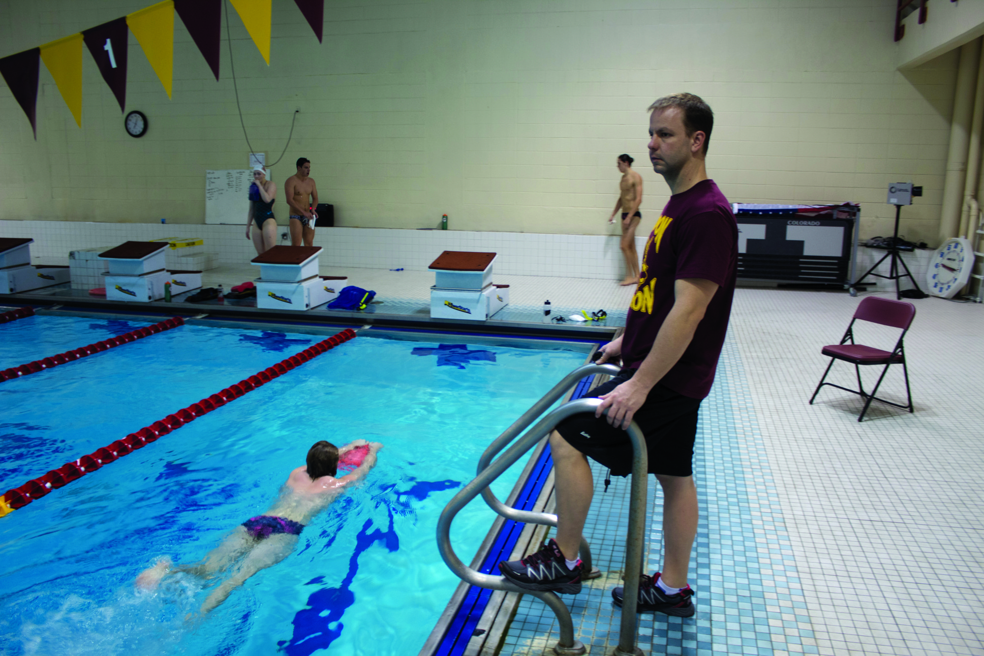 Thomas Natal, Head Coach, trains the Loyola swimmers as they eagerly improve their times and hone their technique.