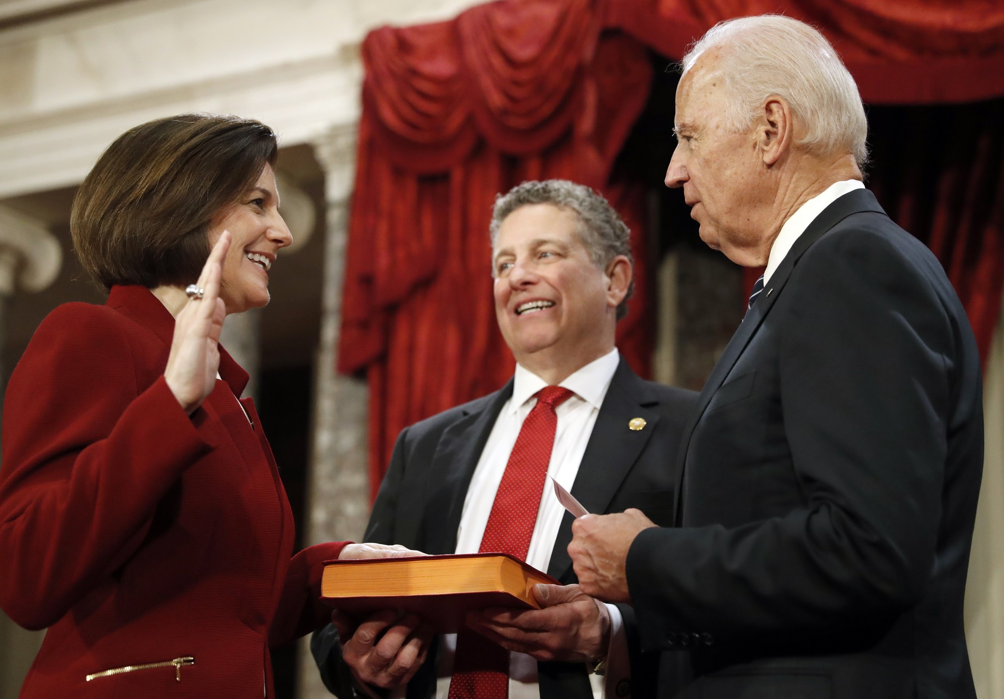 Vice President Joe Biden, right, administers the Senate oath of office to Sen. Catherine Cortez Masto, D-Nev., during a mock swearing in ceremony in the Old Senate Chamber on Capitol Hill in Washington, Tuesday, Jan. 3, 2017, as the 115th Congress begins. Cortez Masto is a Gonzaga University alumna and the first Latina woman elected to Congress. (AP Photo/Alex Brandon)