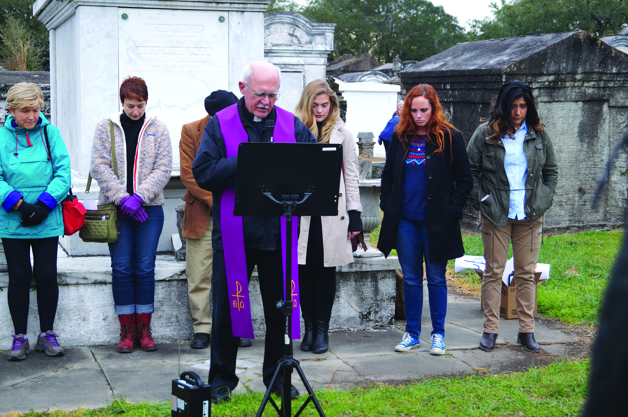 The Rev. Fred Kammer, S.J., director of the Jesuit Social Research Institute, leads a group of protestors in prayer at Lafayette Cemetery No. 1 on Jan. 28. The protest was against repealing the Affordable Care Act and Medicaid expansion in Louisiana. Photo credit: Colleen Dulle