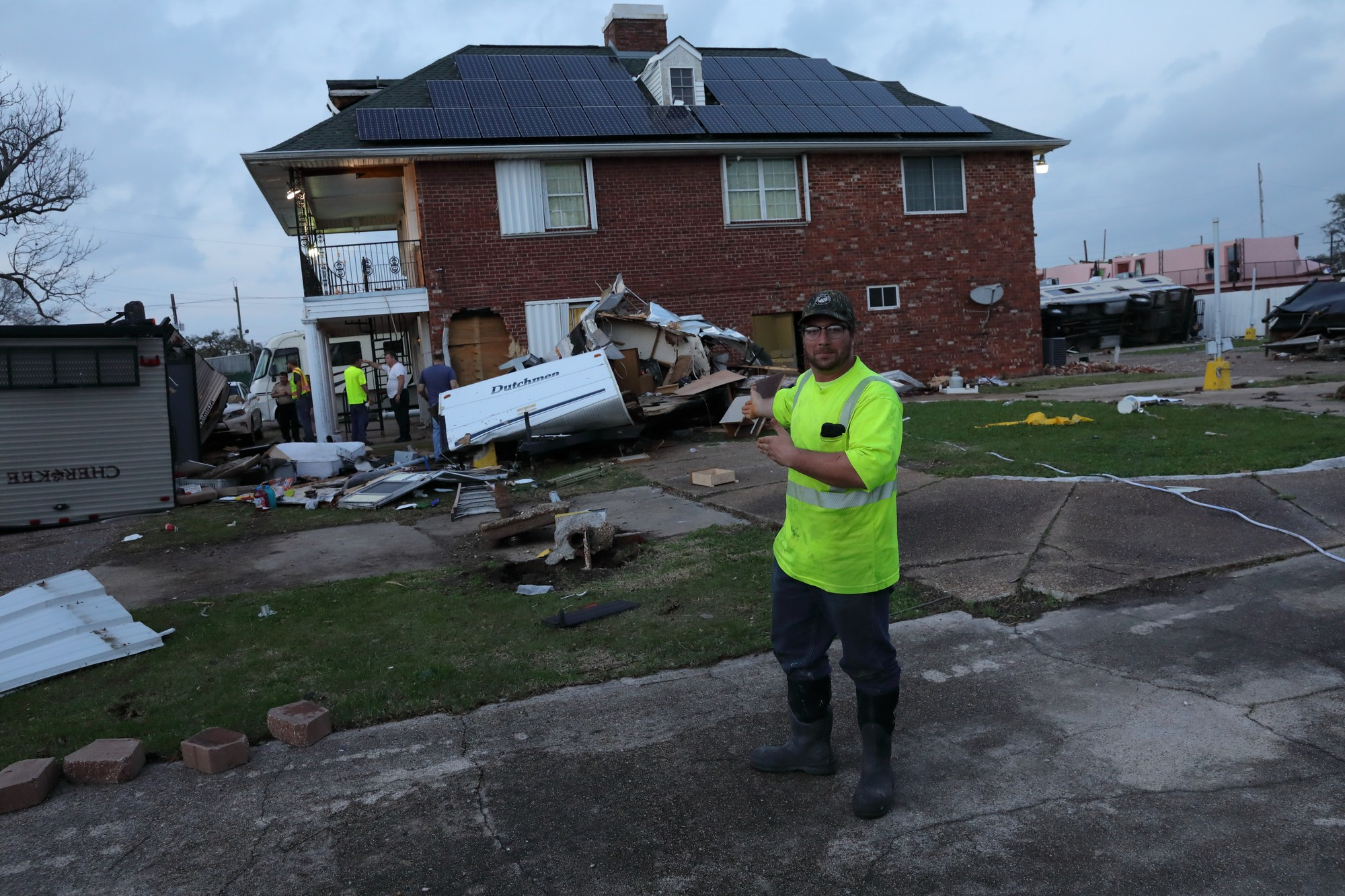 Christian+Nibert%2C+Hayward+Baker+equipment+operator%2C+stands+where+his+trailer%2C+now+behind+him+due+to+an+EF2+tornado%2C+once+stood+at+Parc+D%27+Orleans+in+East+New+Orleans%2C+Louisiana%2C+Feb.+7%2C+2017.+Nibert+and+his+neighbors+worked+together+to+help+one+another+recover+from+the+catastrophe.+Photo+credit%3A+Osama+Ayyad