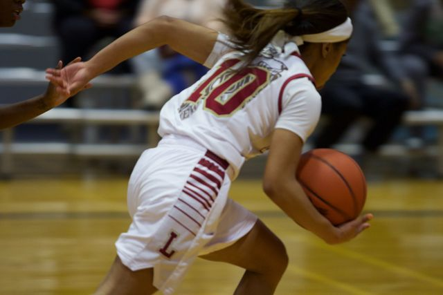 A+Loyola+player+hustles+up+court+in+their+game+on+Jan.+26.+The+Wolf+Pack+fell+to+Brenau+University+85-78.+Photo+credit%3A+Marisabel+Rodriguez
