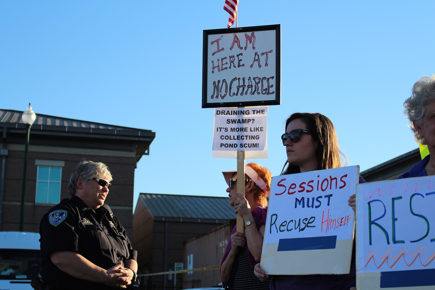 Officer+J.+Morse+and+Joyce+Thomas+talk+while+waiting+for+Sen.+Bill+Cassidy+to+leave+the+town+hall+meeting.+Several+dozen+people+gathered+around+Jefferson+Parish+Library+to+give+their+testimonials+in+protest+to+Sen.+Bill+Cassidy%27s+town+hall+on+Feb.+23%2C+2017.+