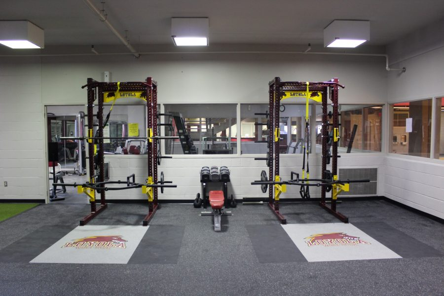 Loyola+weight+room+users+hit+the+gym+heavy+with+new+advanced+squat+machines+and+other+safer%2C+much+improved+equipment.+The+renovations+began+at+the+end+of+last+semester+and+were+expected+to+be+complete+by+Feb.+7%2C+but+the+athletic+department+officially+re-opened+its+doors+to+all+the+sweat+seekers+a+week+behind+schedule.+Photo+credit%3A+Tristan+Emmons