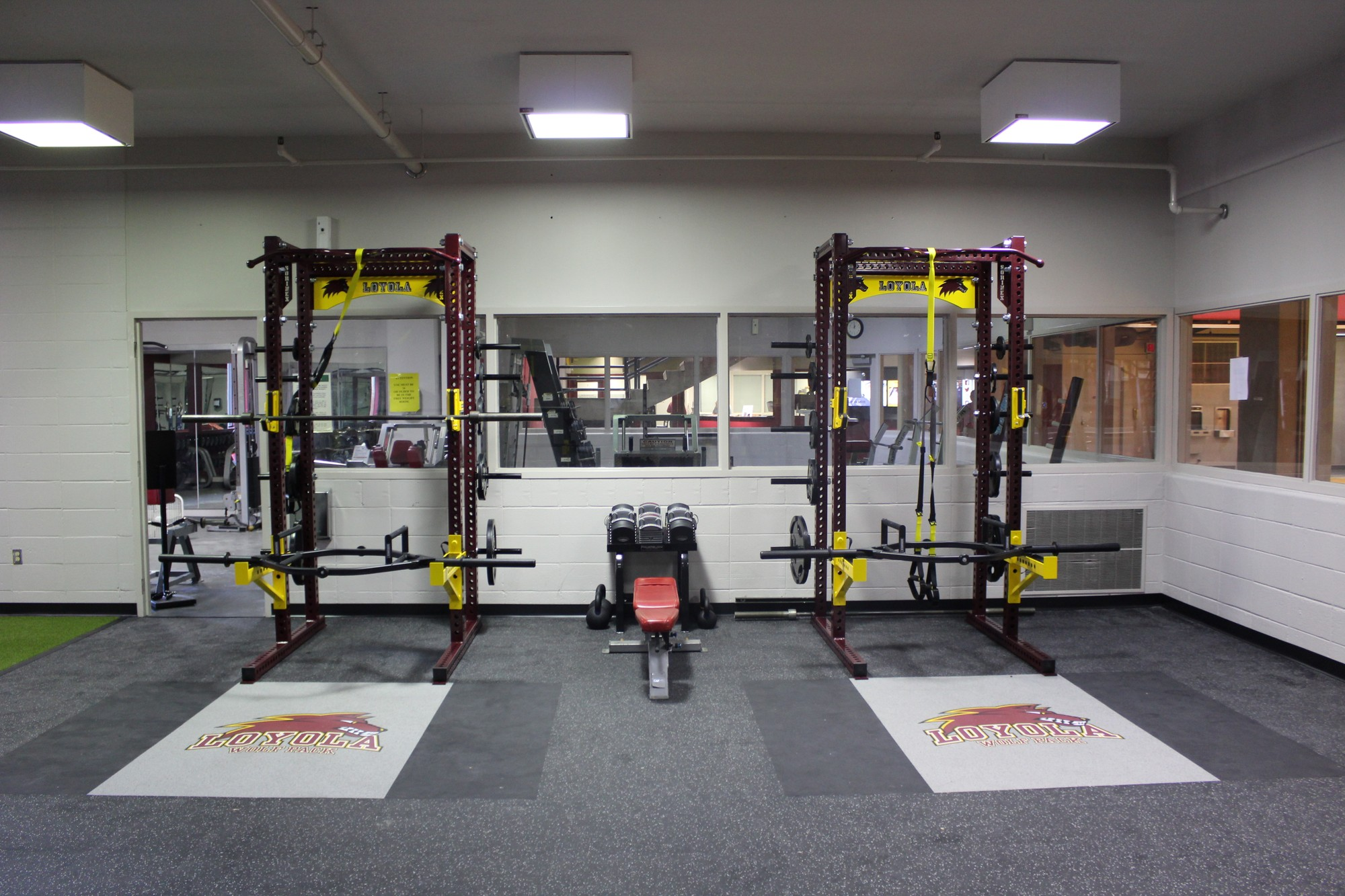 Loyola weight room users hit the gym heavy with new advanced squat machines and other safer, much improved equipment. The renovations began at the end of last semester and were expected to be complete by Feb. 7, but the athletic department officially re-opened its doors to all the sweat seekers a week behind schedule. Photo credit: Tristan Emmons