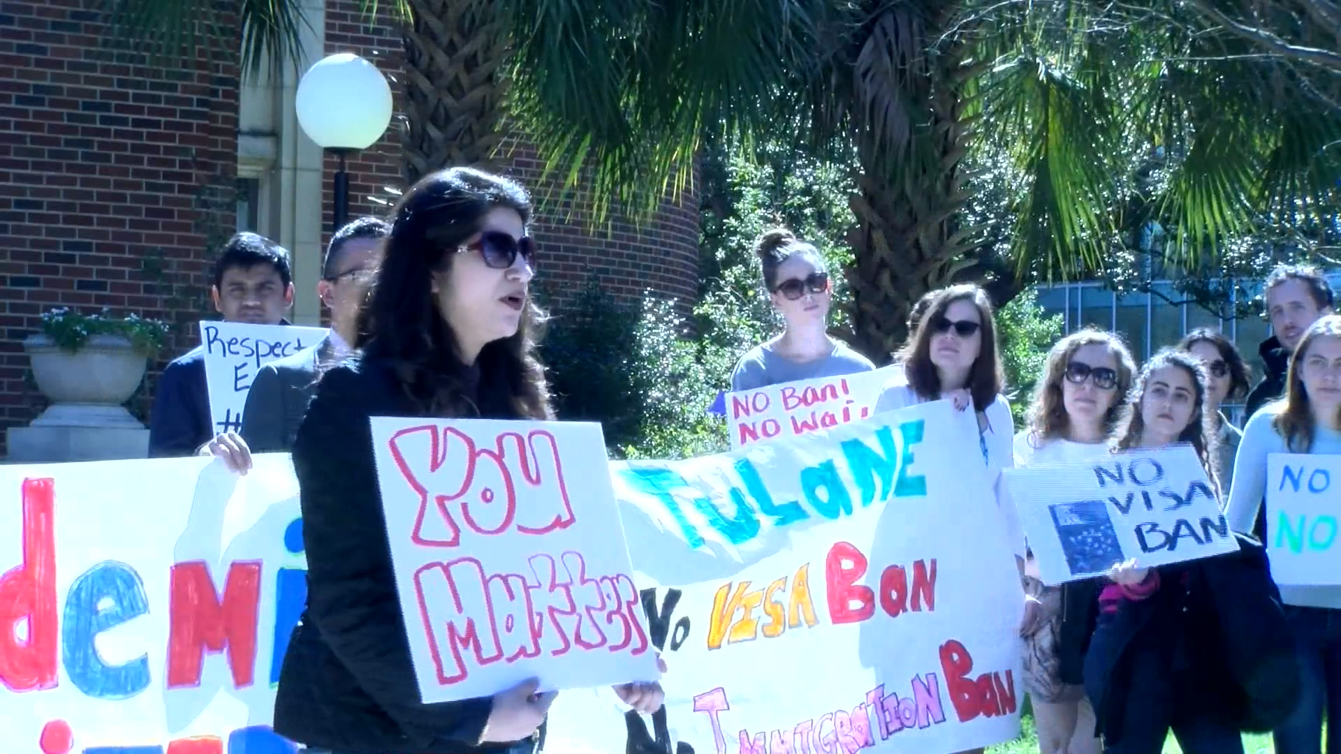 Students, faculty and staff denounce President Trump's executive order travel ban at an Academics United demonstration at Tulane University. An immigrant from Pakistan spoke to demonstrators about issues she faces as an immigrant in the U.S. Photo credit: Alliciyia George