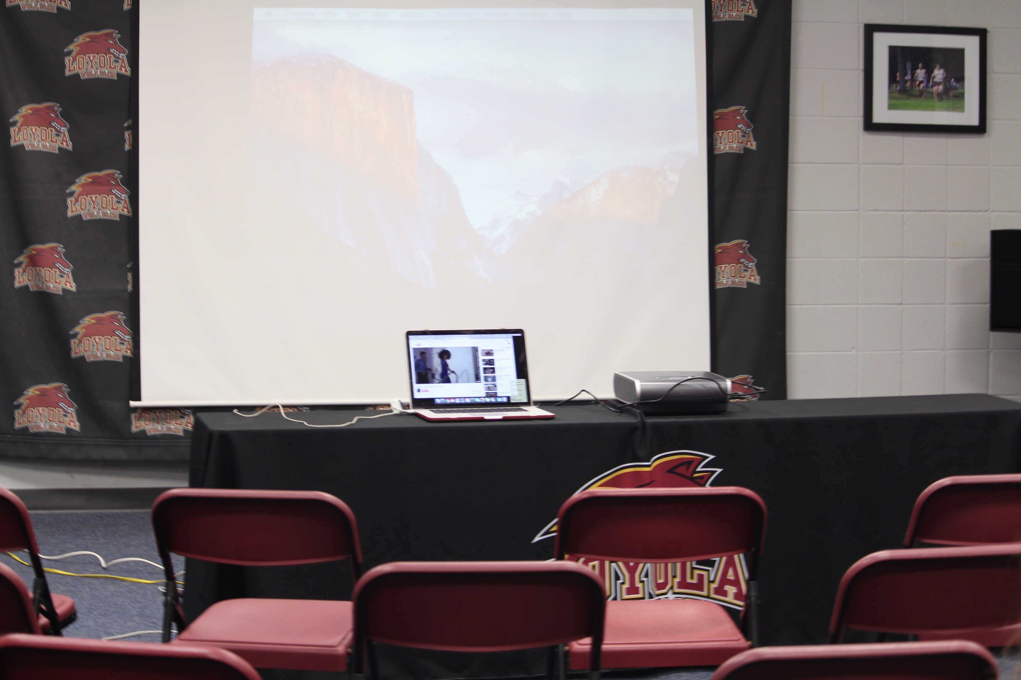 Chairs are set up for the viewing party for Loyola women's basketball. The team fell in the first round of the NAIA tournament. Photo credit: Taylor Ford