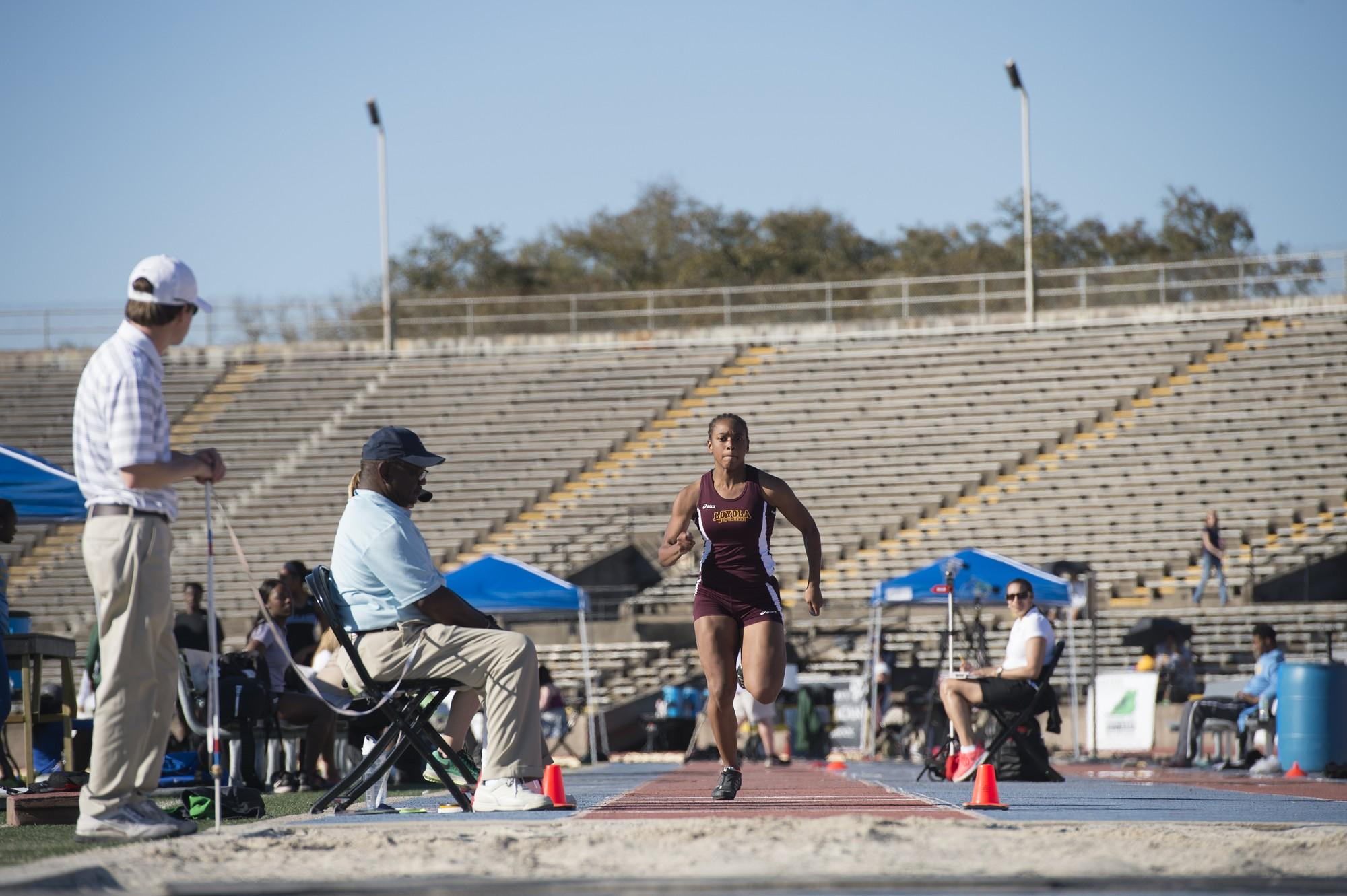 Leah Banks, mass communication sophomore, races toward the sand during the long jump competition at the Tulane Twilight Invitational on March 4, 2016. Banks led Loyola in different categories for the women's team. Photo credit: Courtesy of Loyola Athletics