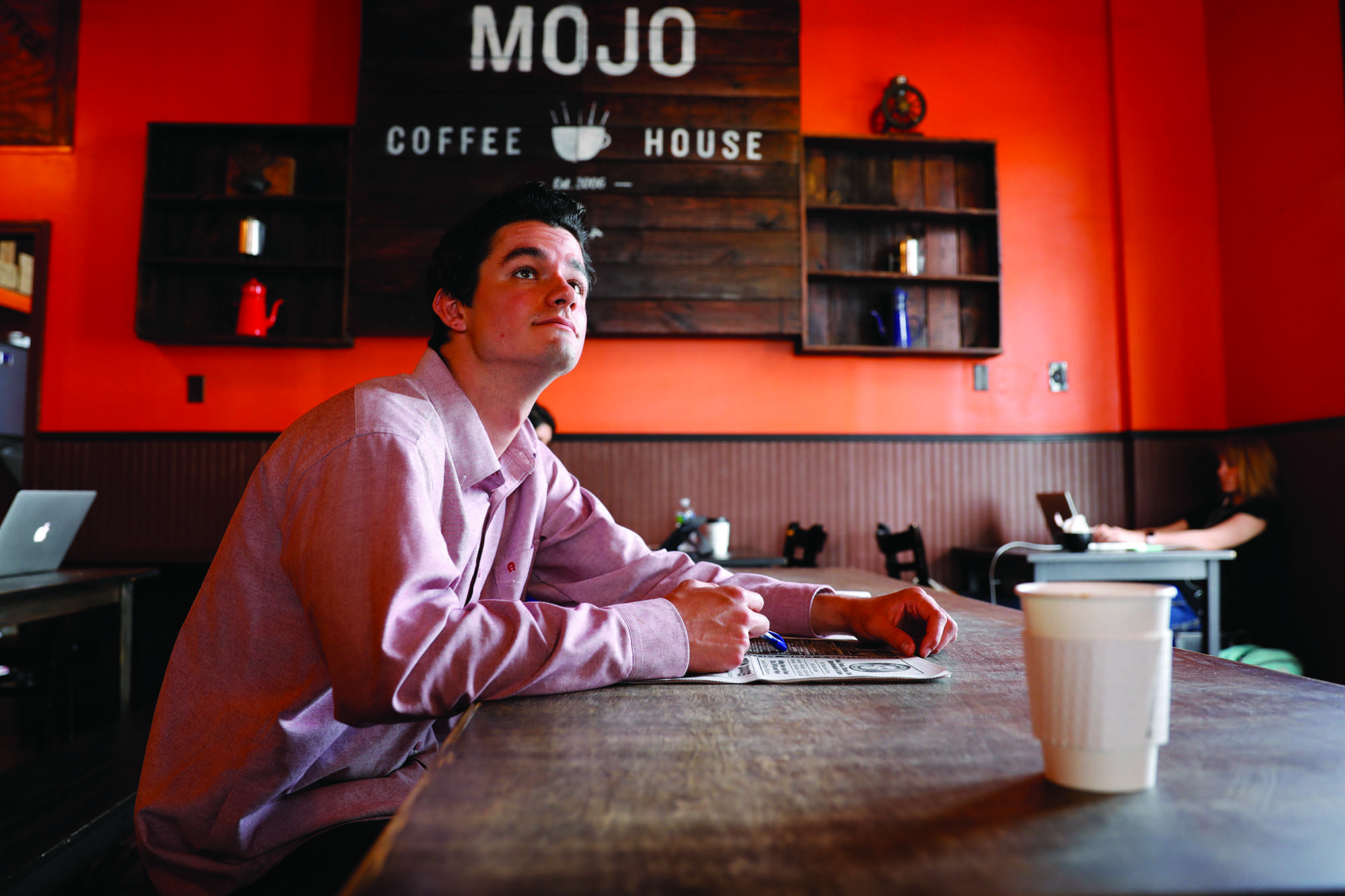 Caleb Beck sits inside Mojo Coffee House. He is one of many who come to enjoy the establishment's food and drinks as well as calm working environment. Photo credit: Barbara Brown