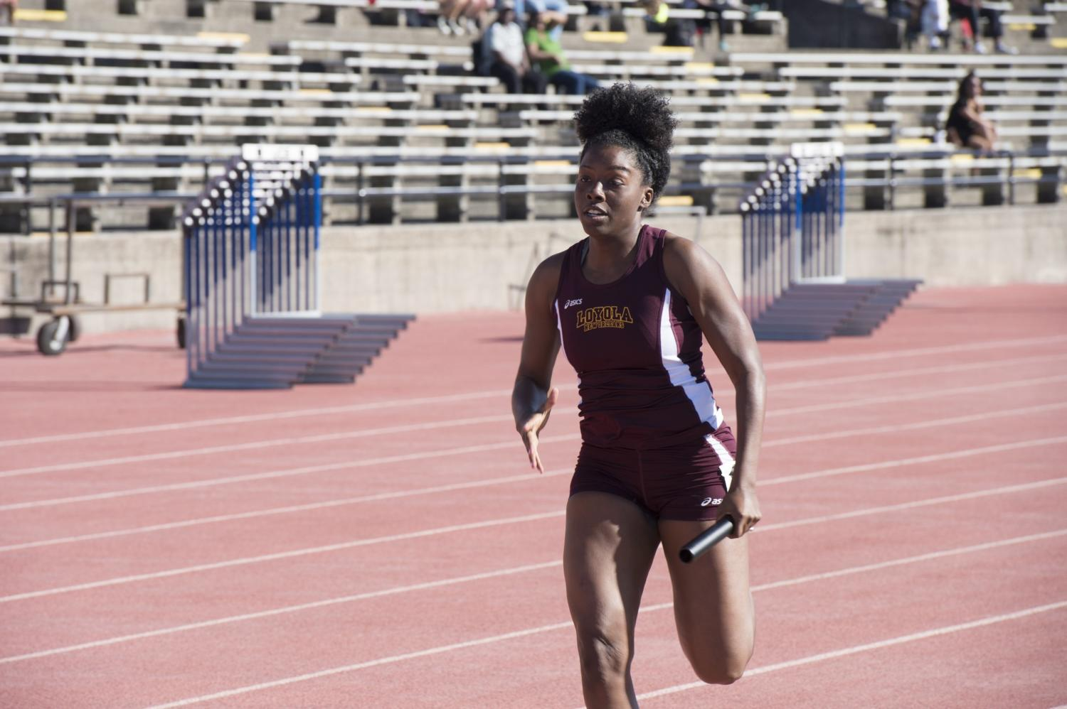 Beaunca Lewis sprints at the Tulane Twilight Invitational on March 4, 2016. The women's track and field team took second while the men's team took fourth at the conference championships. Photo credit: Courtesy of Loyola Athletics