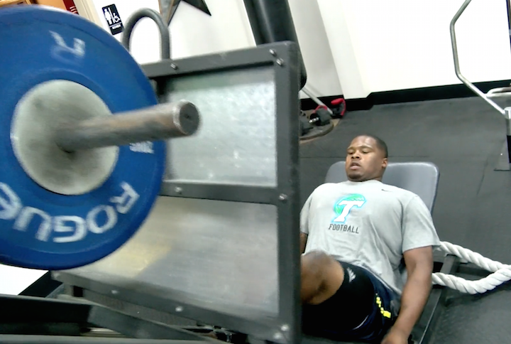 Tanzel Smart, Green Wave defensive tackle, does leg presses in the gym. With the NFL draft beginning on Thursday and going into the weekend, Smart awaits the phone call that will determine his NFL future.