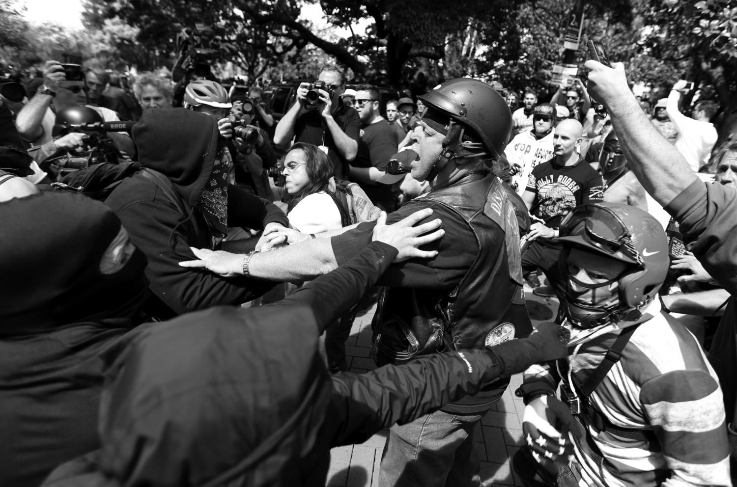 Anti- and pro-Trump supporters clash during competing demonstrations at Martin Luther King Jr. Civic Center Park in Berkeley, Calif., on Saturday, April 15, 2017. (Anda Chu/Bay Area News Group/TNS)