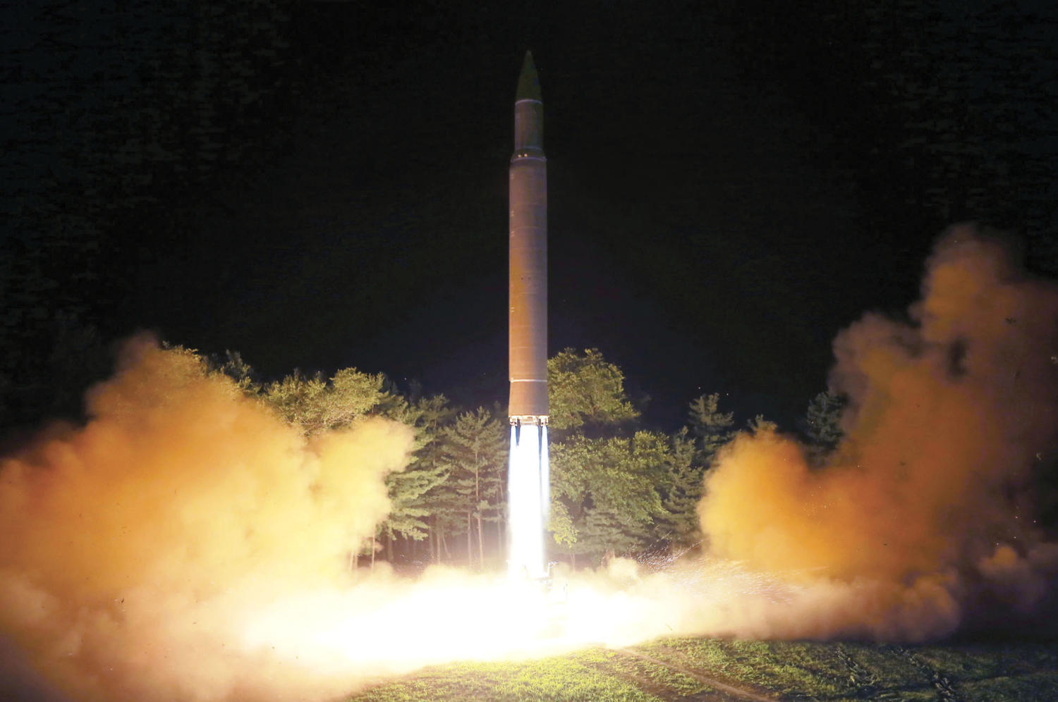 FILE - This July 28, 2017, file photo distributed by the North Korean government shows what was said to be the launch of a Hwasong-14 intercontinental ballistic missile at an undisclosed location in North Korea. America's annual joint military exercises with South Korea always frustrate North Korea. Some experts say North Korea is mainly focused on the bigger picture of testing its bargaining power against the United States with its new long-range missiles and likely has no interest in letting things get too tense during the drills. (Korean Central News Agency/Korea News Service via AP, File)
