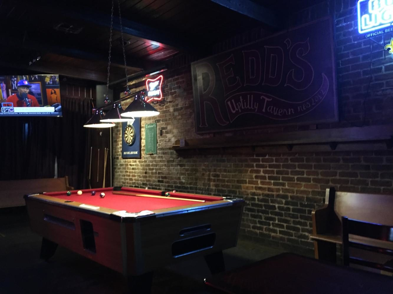 The+pool+table+lays+idle+within+Redd%27s+Uptown+Tavern.+Reid%27s+is+one+of+several+college+hangouts+on+Maple+Street.+Photo+credit%3A+Caleb+Beck