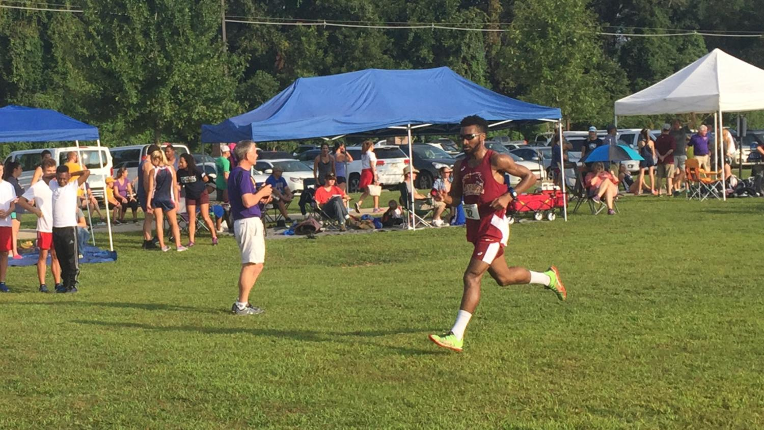 Cross country runner Brian Davis competes at the LSU Cross Country Festival on Sept. 16, 2017. The Loyola cross country team finished 7th overall at the event. Photo credit: Jc Canicosa