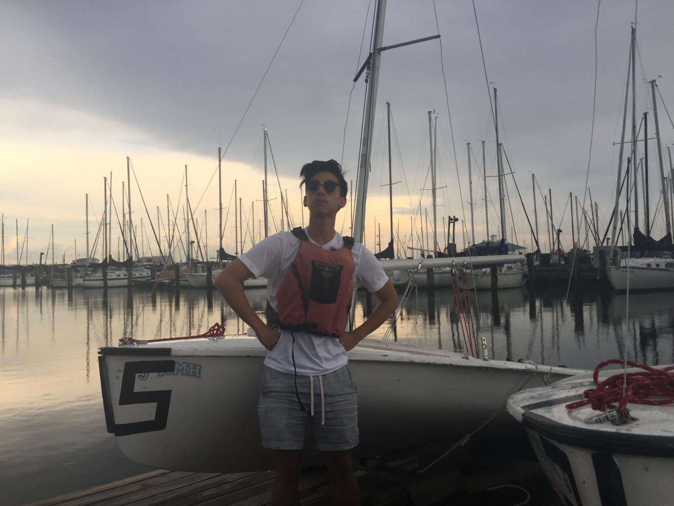Sports editor JC Canicosa stands in a satirically heroic pose, ready to take on what Lake Pontchartrain throws at him. Photo credit: Sophie Duffy