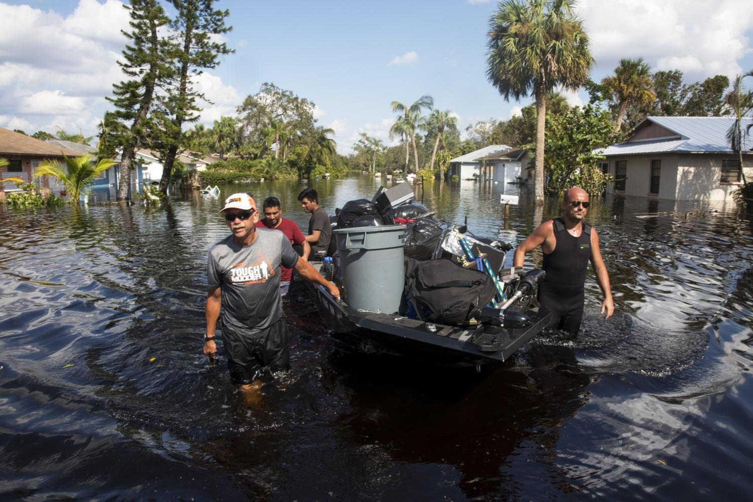 Don+Manley%2C+left%2C+and+Pedro+Castellano%2C+right%2C+pull+Manley%27s+boat%2C+loaded+with+residents%27+belongings%2C+along+a+flooded+Chapman+Avenue+in+Bonita+Springs%2C+Fla.%2C+on+Friday%2C+Sept.+15%2C+2017%2C+in+the+aftermath+of+Hurricane+Irma.+%0A+%28Nicole+Raucheisen%2FNaples+Daily+News+via+AP%29+Photo+credit%3A+Associated+Press