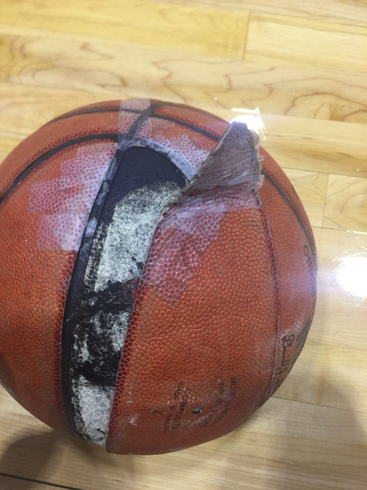 A basketball in the sports complex is held together by tape. Photo credit: Jc Canicosa