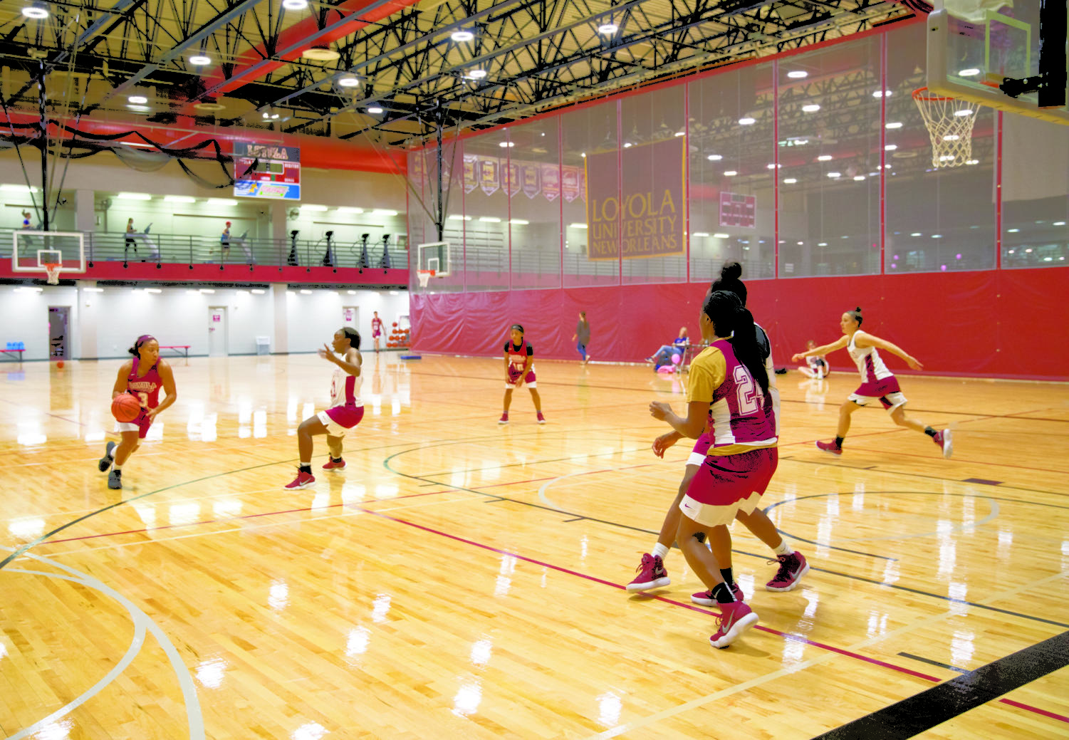 The women's basketball team practices at The Den. The team hopes to progress on a successful season last year. Photo credit: Julia Santos
