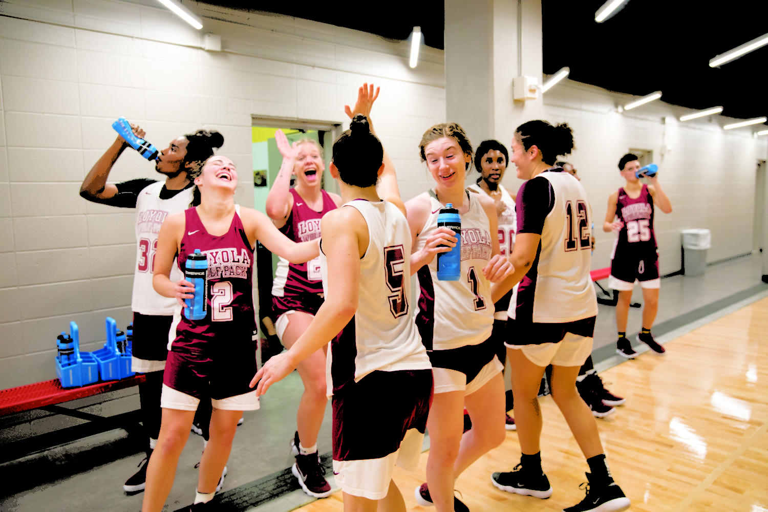 Women's basketball team enjoying a refreshing water break. The practice was held in the Loyola University sports complex on Friday. Photo by Jules Santos. Photo credit: Jules Santos