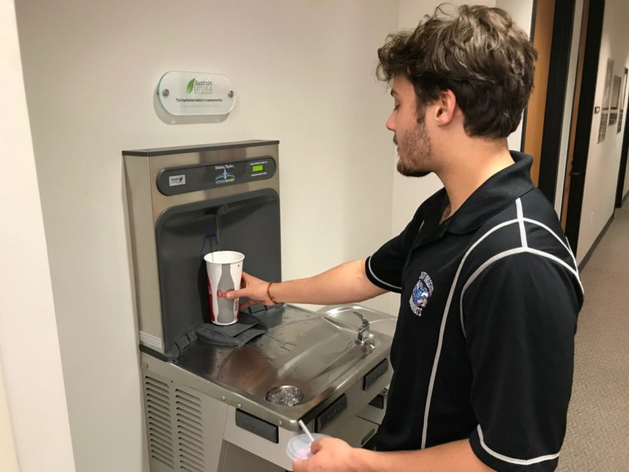 Mass+communication+junior+Nick+Boulet+uses+a+water+refill+station+in+the+Monroe+Library.++The+stations+have+eliminated+waste+from+millions+of+water+bottles.+Photo+credit%3A+John+Casey