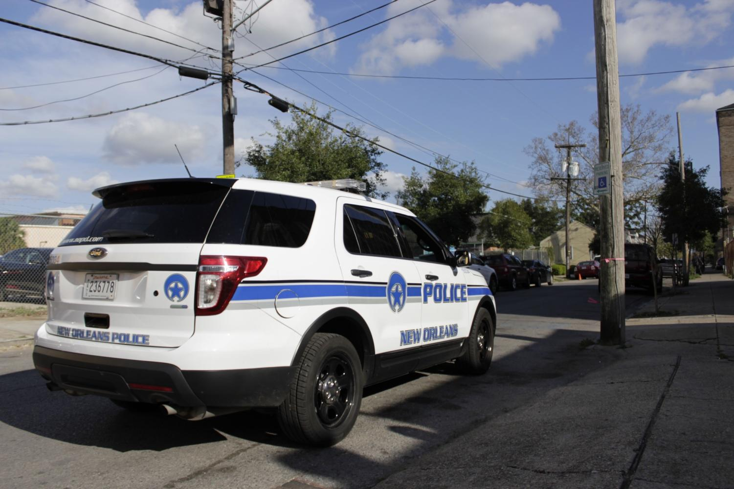 A New Orleans Police Department vehicle sits outside as an officer responds to a call in the Lower Garden District.  Police in the Uptown area are on high-alert as vehicle-related crimes have spiked up in recent months. Photo credit: John Casey