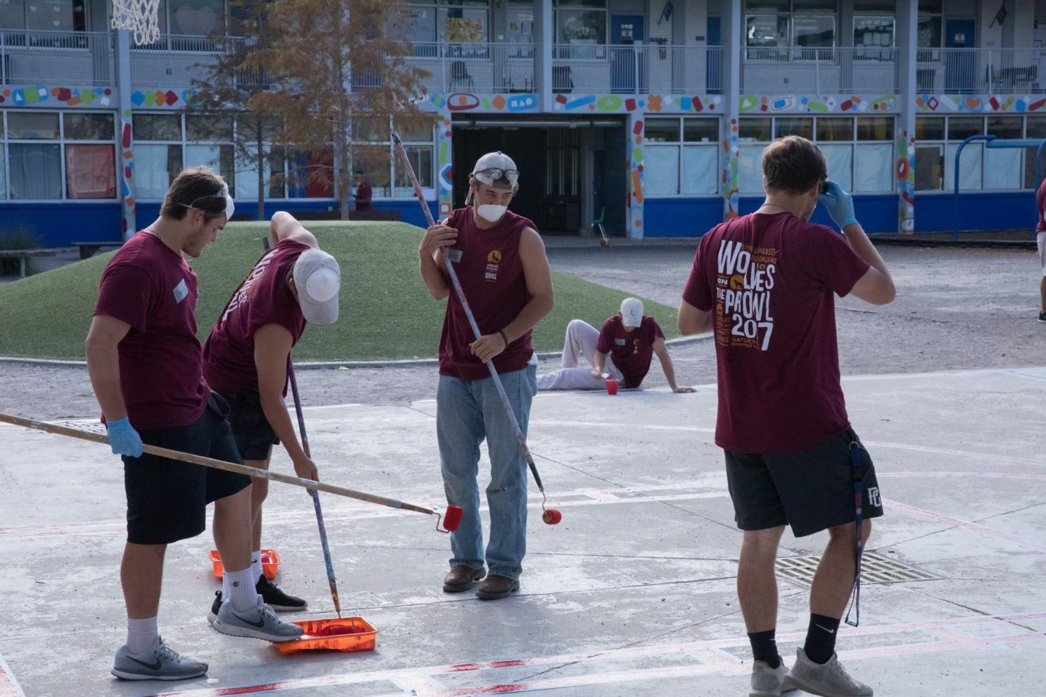 Loyola baseball team helps out at Loyola's National Day of Community Service, Wolves on the Prowl, Nov. 4th. Photo by Lili Mae Kinney.