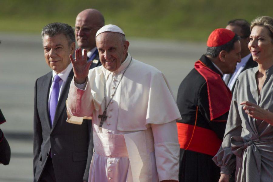 Pope+Francis+waves+next+to+Colombian+President+Juan+Manuel+Santos%2C+left%2C+during+his+welcoming+ceremony+upon+landing+in+Bogota%2C+Colombia%2C+on+September+6%2C+2017.+%28Daniel+Garzon+Herazo%2FNurPhoto%2FSipa+USA%2FTNS%29