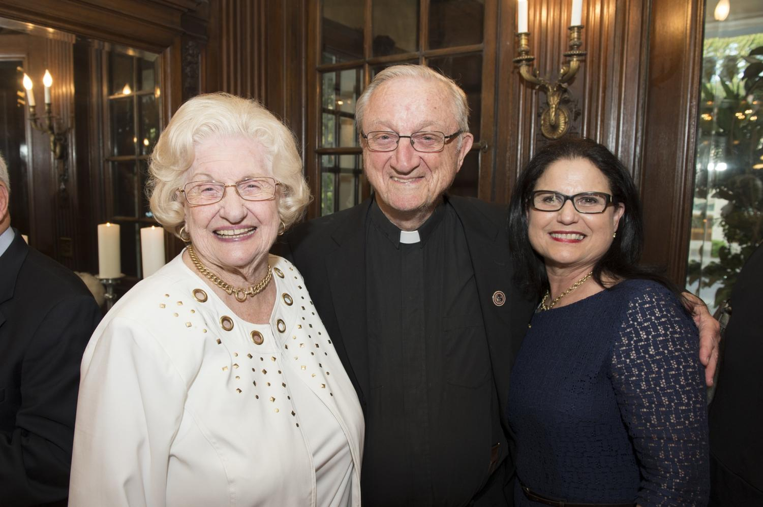 Maedell Hoover Braud (left), the Rev. James Carter, S.J., and Marla Donavan pictured at the 2015 Heritage Society Reception. Braud was recognized consistently throughout her lifetime for supporting Loyola and a number of Jesuit institutions Photo credit: courtersy of Monique Gardner