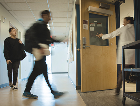Students Rush to an anatomy and physiology lab Jan. 12, 2018, in Monroe Hall. The 12:30 class had seven students waitlisted that day. It had one of the largest waitlists at the time. Photo by Julia Santos. Photo credit: Julia Santos