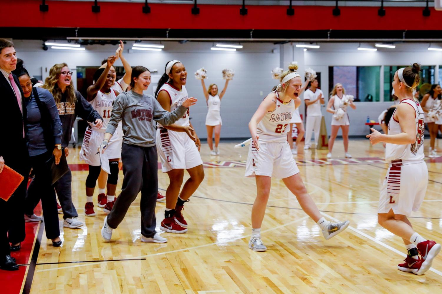 Junior, #23 Megan Worry celebrating with, freshman, #5 Savannah Ralph after the team won the game against Faulkner University in the Den on Jan. 20, 2018. The team is now 13-4 for the season. Photo credit: Jules Lydon