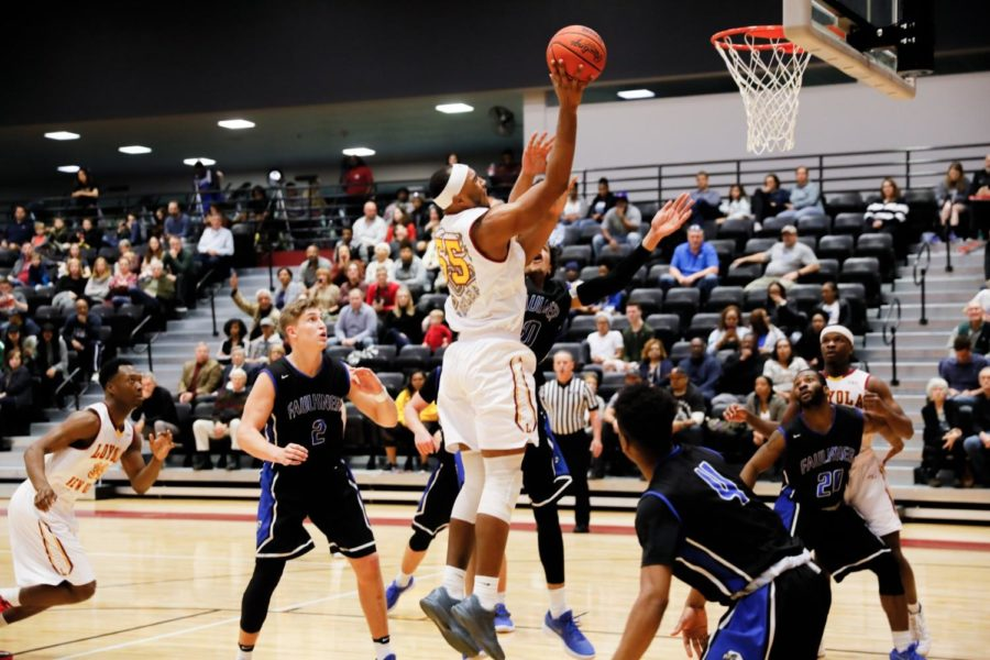 Senior%2C+%2355+Benjamin+Fields%2C+rebounds+and+shoots+the+ball.+Fields+led+the+team+with+a+total+of+14+points+at+the+Faulkner+University+game+in+the+den+Jan.+20%2C+2018.+Photo+credit%3A+Julia+Santos