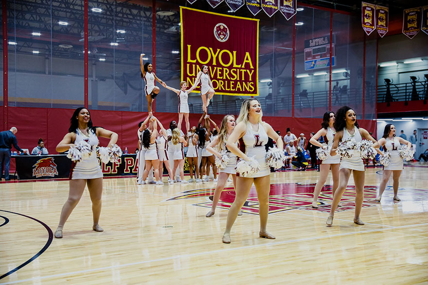 The Loyola dance and cheer teams perform a halftime routine at the University Sports Complex Jan. 20, 2018, during Loyola's women's basketball game against Faulkner University. The dance team is gearing for a dance team championship Feb. 3, in Mobile, Alabama. Photo credit: Julia Santos