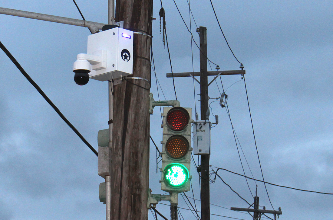 A crime camera flashes at the corner of Broadway and Freret on Feb. 27, 2018. 250 new cameras will be installed in the city this year. ANNA KNAPP/The Maroon.