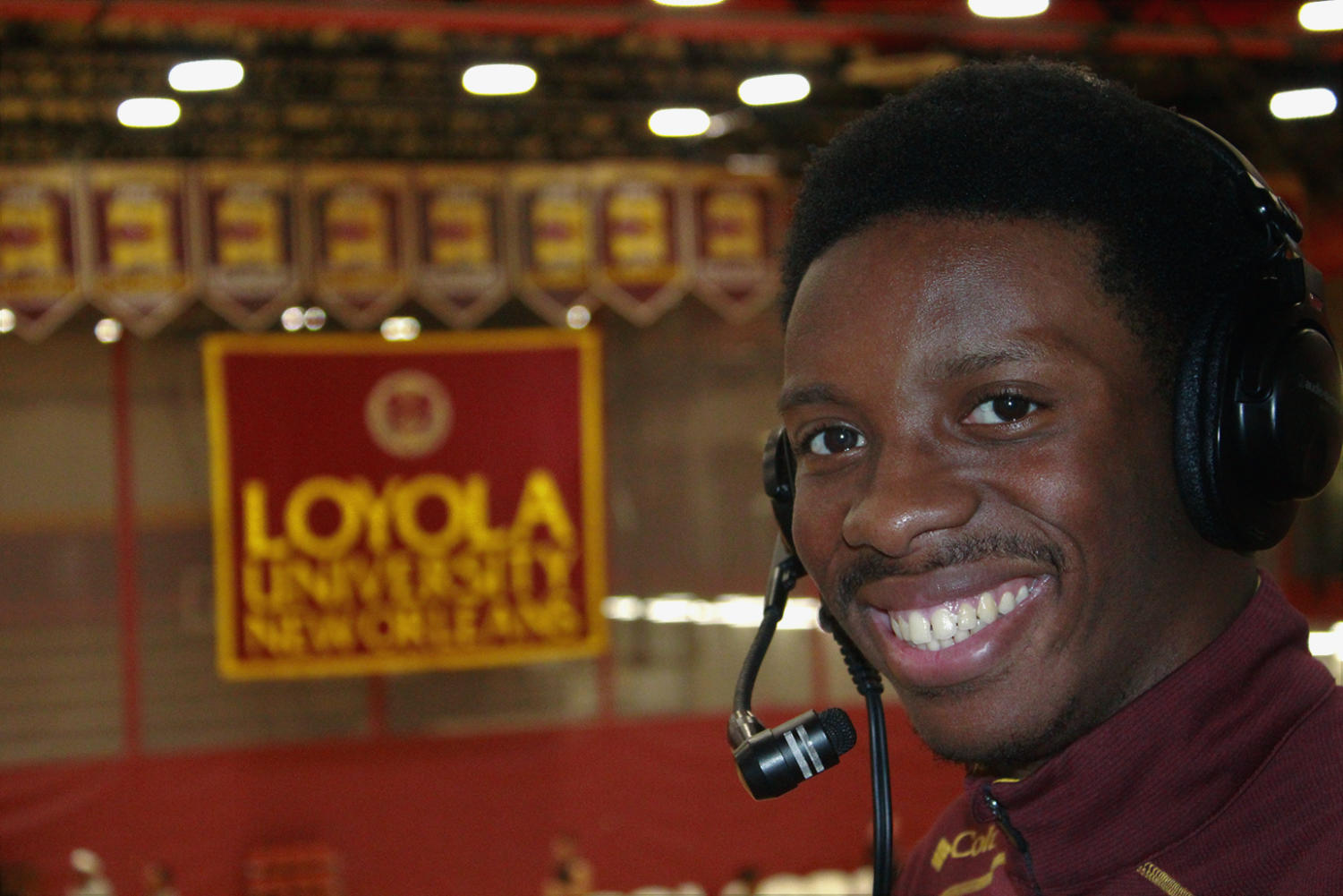 RoSha'e Gibson, mass communication sophomore, broadcasts live at home basketball and volleyball games. In his only second year on the job, Gibson hopes to expand his broadcasting to Loyola baseball. Photo credit: Paola Amezquita