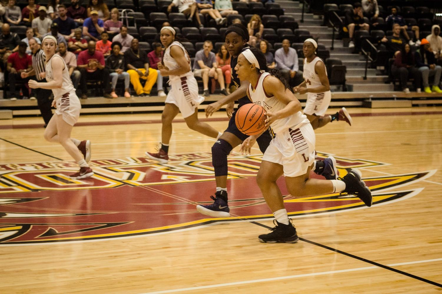 Biology senior Di'Mond Jackson (3) dribbling down the court at a home women's basketball game against Blue Mountain College Feb. 24, 2018. The game honored the team's seniors Jackson and mass communication senior Zoie Miller (10). Photo credit: Julia Santos