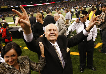 File- This Dec. 19, 2009, file photo shows New Orleans Saints owner Tom Benson walking on the field before the NFL football game against the Dallas Cowboys in New Orleans.  Benson, a successful auto dealer who brought the New Orleans Saints their only winning seasons and the