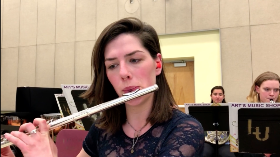 Allison+Hasson+plays+the+flute+during+her+rehearsal+at+Loyola+on+March+8%2C+2018.+Hasson+plays+with+earplugs+at+each+rehearsal.+ANNA+KNAPP%2FThe+Maroon.+Photo+credit%3A+Anna+Knapp
