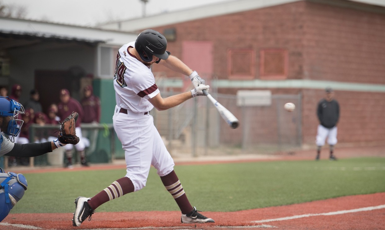 Ben Condara (14), general studies business senior, swings at a pitch. The Loyola baseball team split their series versus Brewton-Parker on April 6 2018. Photo credit: Loyola University Athletics