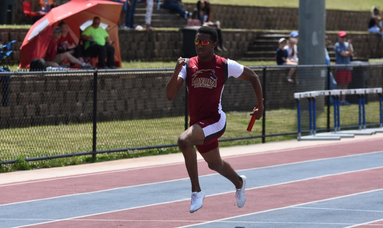Computer information systems Jarrett Richard competing in a relay at the Southern States Athletic Conference Track and Field Championships on April 21, 2018. The women's team finished in third place overall while the men's team placed in fifth. Photo credit: Loyola University Athletics