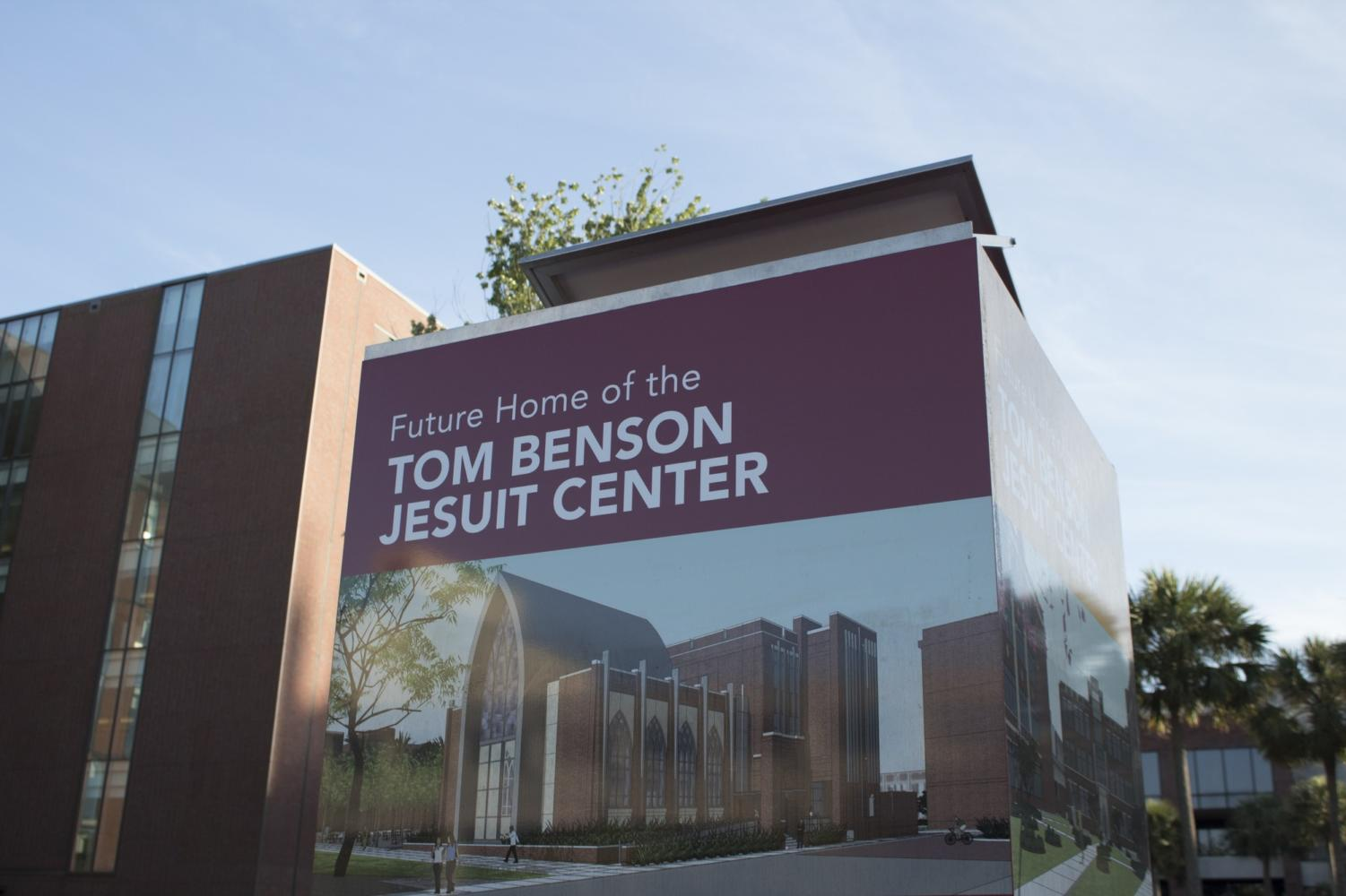 The sign for the future site of Tom Benson Jesuit Center stands between Monroe Hall and the sculpture garden. CHRISTIAN ORELLANA/The Maroon. Photo credit: Cristian Orellana
