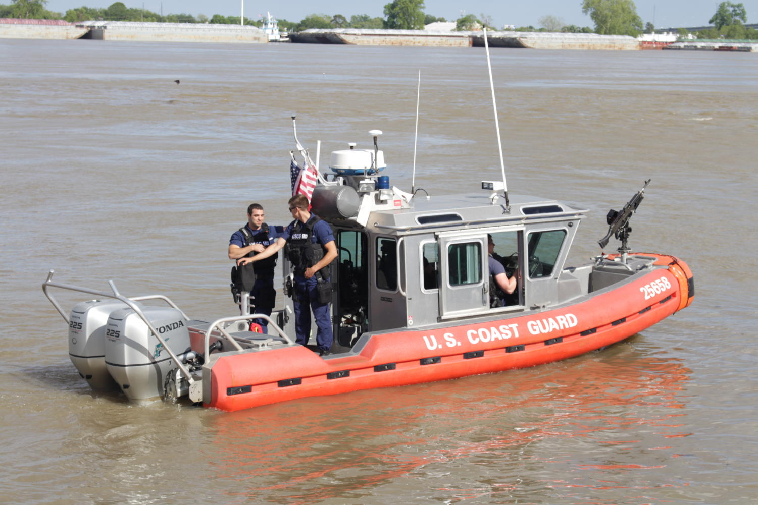 The U.S. Coast Guard monitor the impact from the oil spill Thursday afternoon. They shut down all traffic on the river and requested the RTA shut down the ferry leading from Algiers to Canal St.