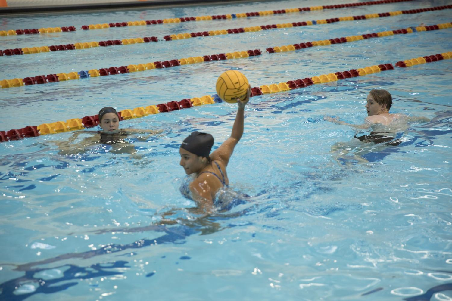 Dhalia Martinez, biology sophomore, takes a shot at a water polo goal during practice on April 4, 2018. Martinez and Aubrey Palhegyi, buisness management senior, both took the reigns of the club sport when their coach could no longer attend practice. Photo credit: Cristian Orellana