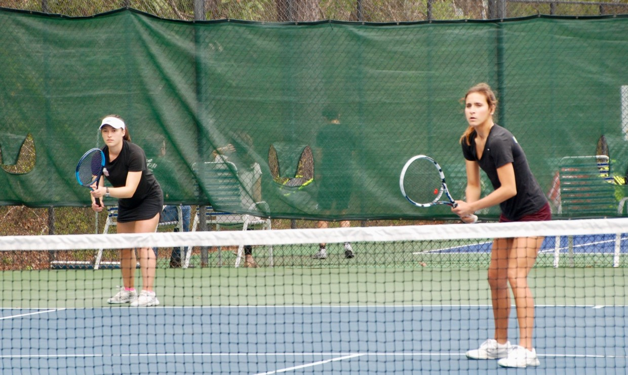 Two Loyola women's tennis players in a doubles match at City Park. Both team lost their matches versus the University of Mobile on April 6 2018. Photo credit: Loyola University Athletics