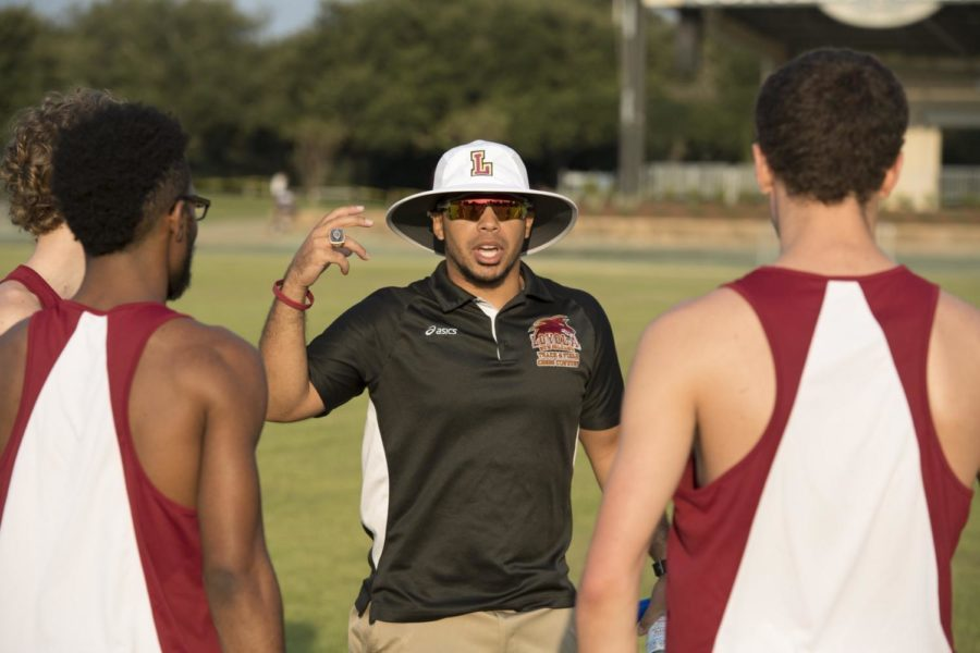Nick+Dodson+coaching+Loyola+track+runners+at+a+competition.+Dodson+will+leave+Loyola+for+the+head+coach+position+at+Southeastern+University+in+Lakeland%2C+Florida+after+coaching+the+Wolf+Pack+for+the+past+two+years.+Photo+credit%3A+Loyola+University+Athletics